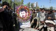 People attend a burial ceremony of General Abdul Razeq
