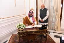 Saudi Crown Prince Mohammed bin Salman signs the Visitor''s Book as Prime Minister Narendra Modi looks on, at Hyderabad House, in New Delhi, on Feb 20, 2019