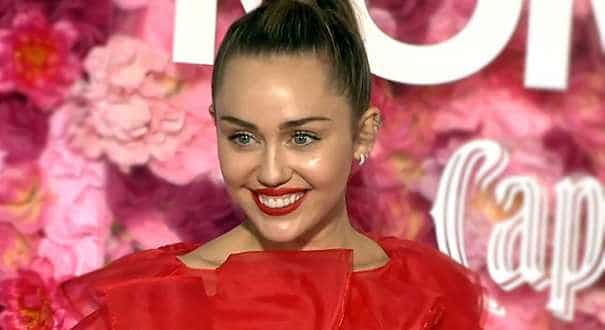 Miley Cyrus takes sick husband's place at movie premiere, joking 'he owes me'