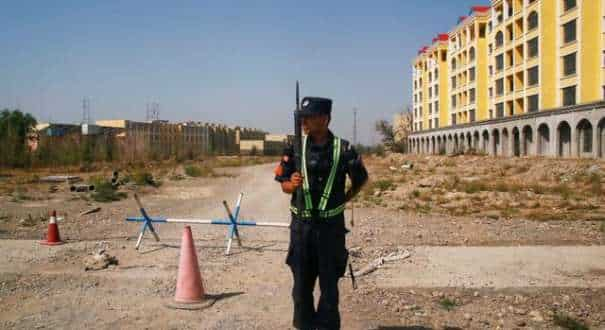 A Chinese police officer outside a vocational education centre in Xinjiang Uighur Autonomous Region