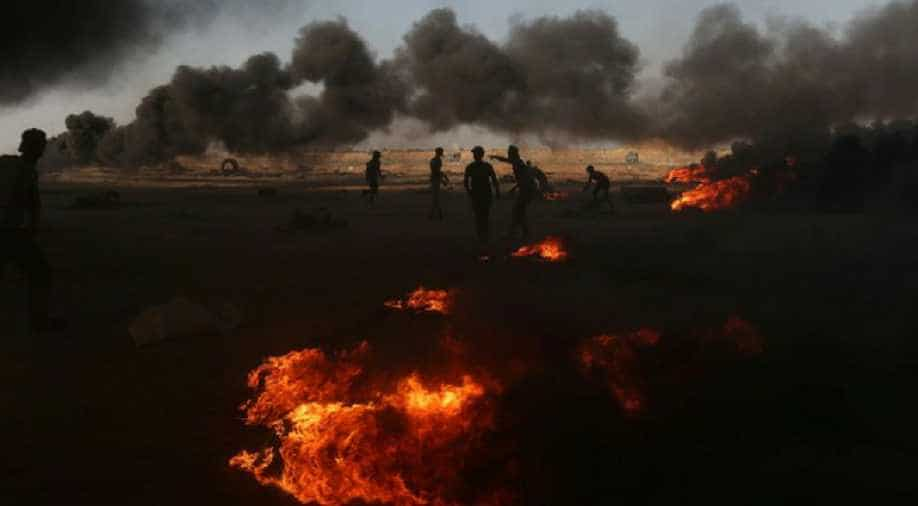 Palestinians say Israeli fire kills 2 at Gaza-Israel fence