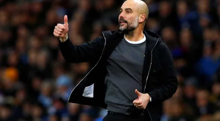 Guardiola putting talk of a Manchester City Quadruple on hold for now