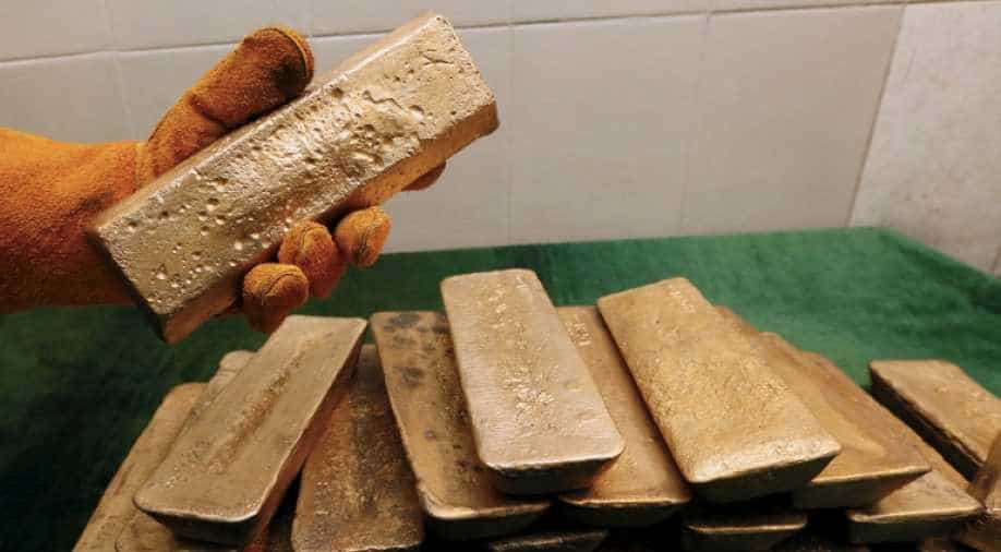Gold climbs to three-month high, poised for best year since 2010
