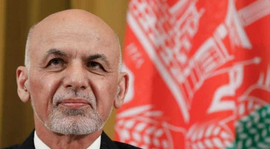Afghan president says peace coming but outsiders can't decide future
