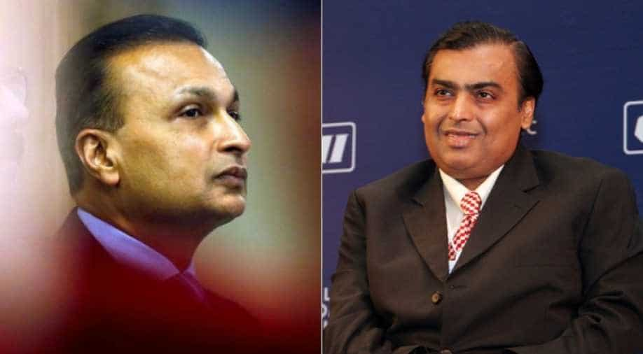 Reliance Communications jumps after Mukesh Ambani bails out brother Anil