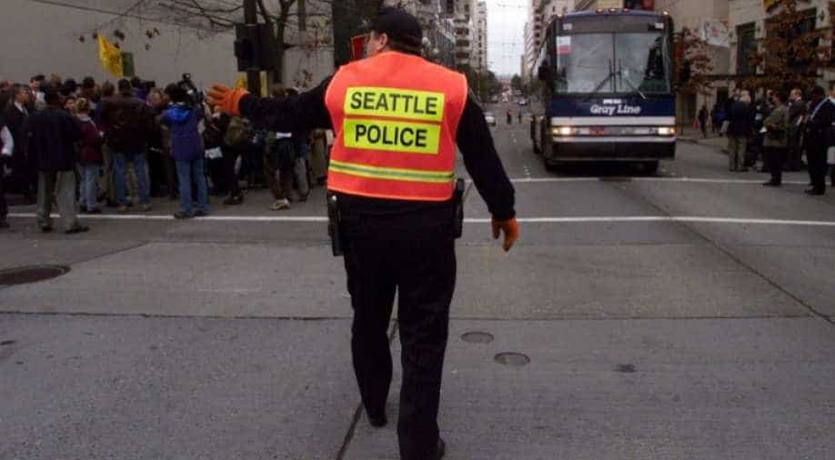 Suspect detained by police in Seattle after 4 people are shot