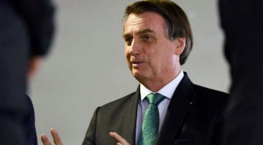 Brazil president threatens to exit WHO as coronavirus death toll rises