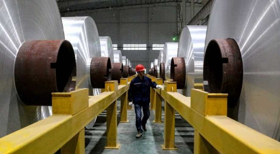 China factory activity unexpectedly returns to growth after 6 months