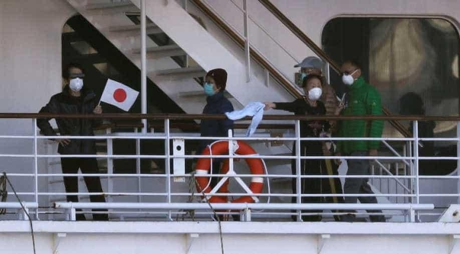 Coronavirus: Cruise ships quarantined off Japan and Hong Kong