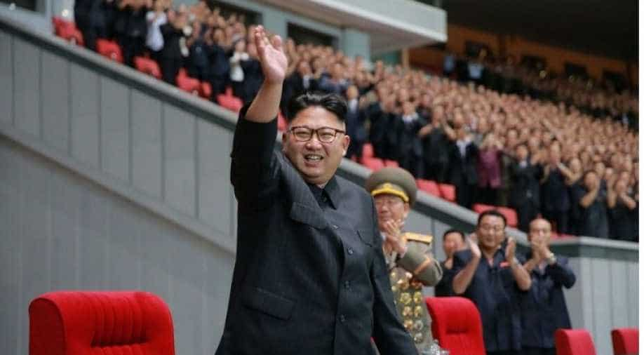 DPRK top leader Kim Jong Un cuts tape for factory completion