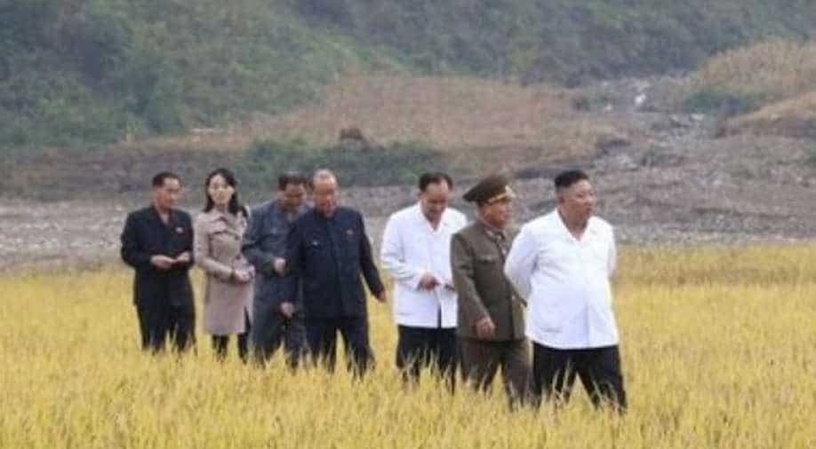 North Korea's Kim tours flood-hit town, sister reappears in public