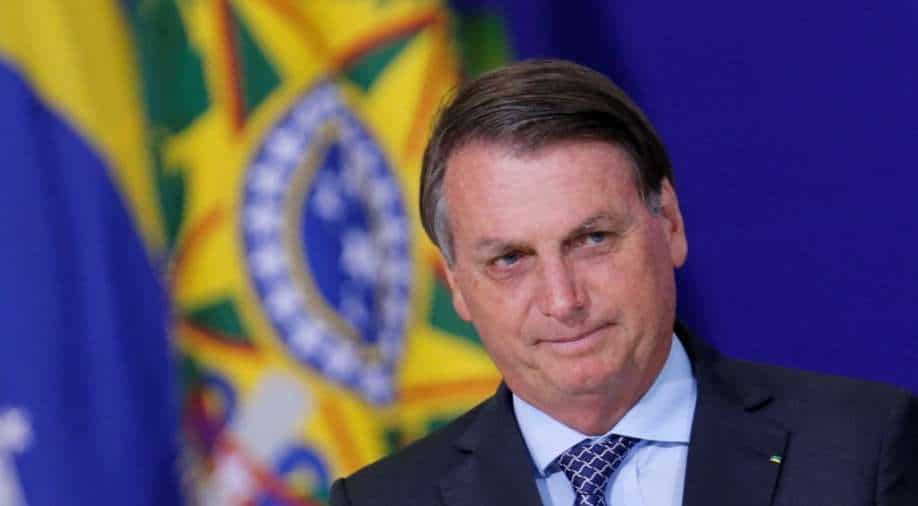 Bolsonaro tells Brazil not to deal with pandemic 'like fags'
