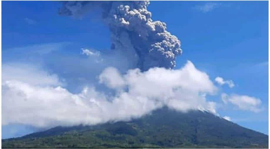Thousands forced to flee after volcano erupts in eastern Indonesia