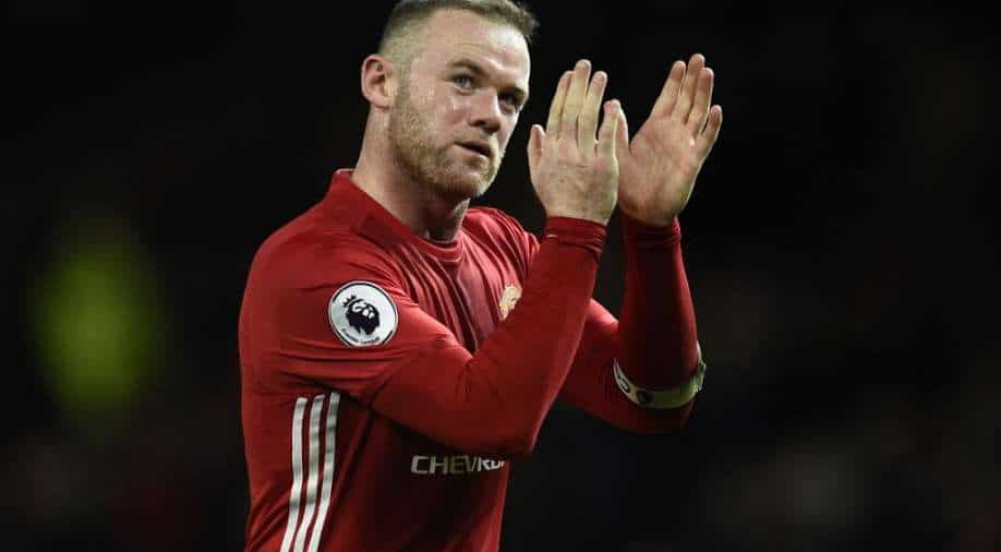 Wayne Rooney retires to become permanent Derby boss