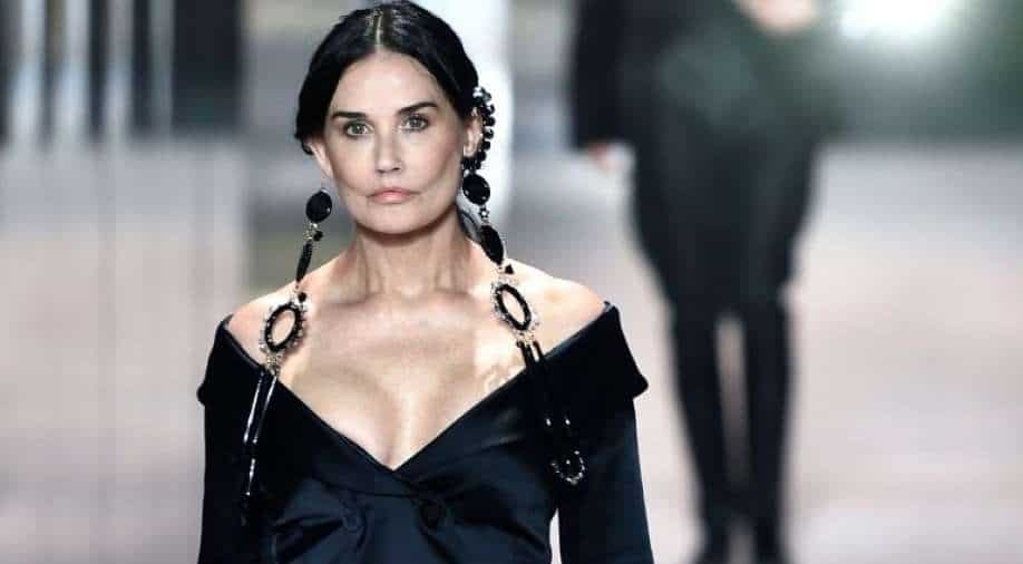 Demi Moore makes a surprise runway appearance at Fendi fashion show