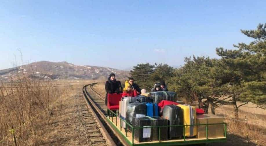 Russian diplomats hand-push trolley over North Korea border