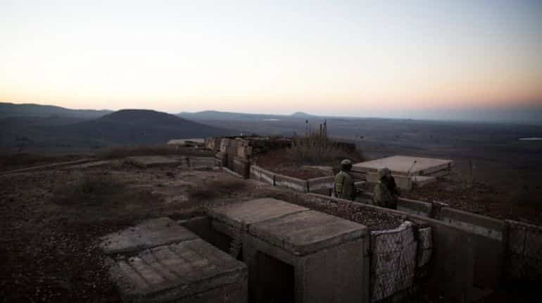 Israeli soldiers stand in a bunker in a training area in the Israeli-annexed Golan Heights