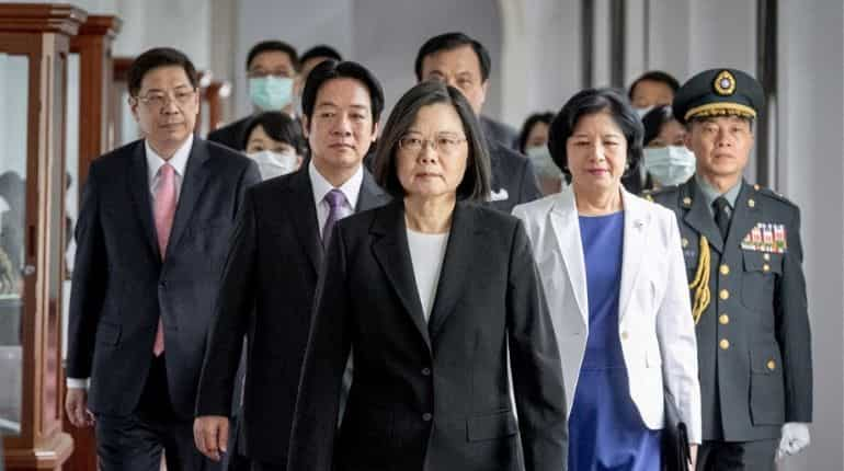 This handout picture taken and released on May 20, 2020 by the Taiwan Presidential office shows Taiwan's President Tsai Ing-wen (C) arriving at the Presidential Office for her inauguration ceremony in Taipei