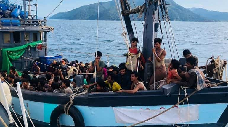 A file photo of a wooden boat carrying suspected Rohingya migrants.