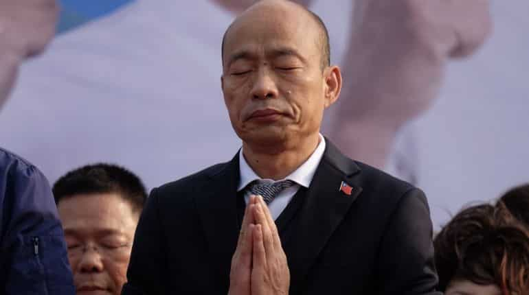 Han Kuo-Yu, Taiwan's presidential candidate prays for the victims killed during a helicopter crash during campaign rally in Tainan