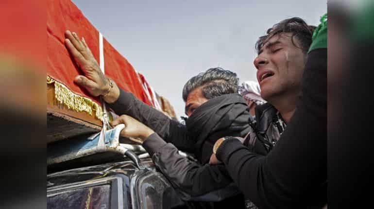 A mourner cries during the funeral of Iraqi paramedic Janat Madhi Hussein