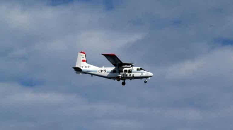 This handout picture taken by Japan Coast Guard on December 13, 2012 shows a Chinese state-owned plane flying in airspace over the disputed island, called the Senkakus in Japanese and Diaoyus in Chinese, in the East China Sea