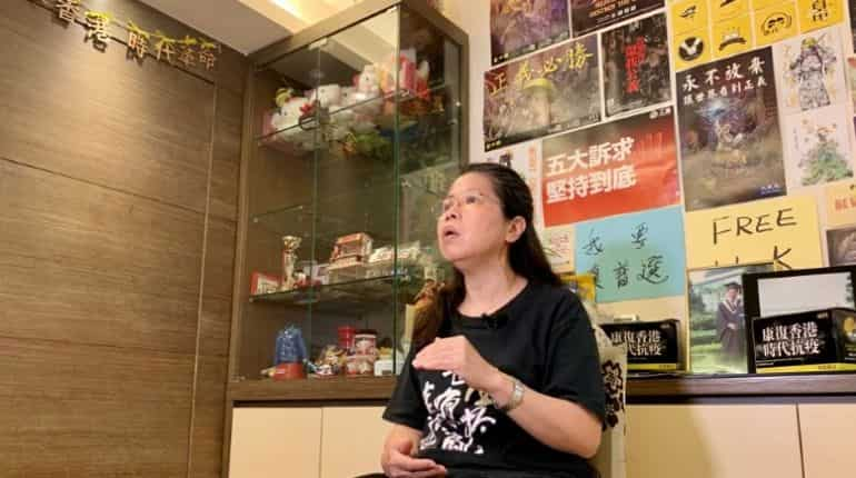 Office worker Daisy Lam speaks to Reuters about her experience in joining the annual June 4 candlelight vigil, at her living room in Hong Kong, China June 1, 2020