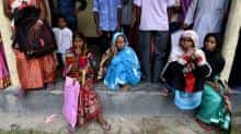 Assam villagers wait outside National Register of Citizens (NRC) centre