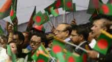 A file photo of people waving Bangladesh flag.