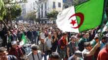 Algerians demonstrate near the May 1st square during the first Friday rally.