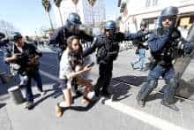"Riot police try to disperse a protester as French ""yellow vests"" stage their 19th round of protests in Nice, France, March 23, 2019"