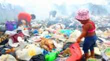 Hungry Venezuelans rummage for food in Brazil landfill