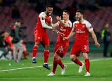 Arsenal's Alexandre Lacazette celebrates scoring their first goal with team mates