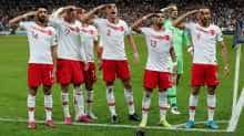 Turkey players salute after Kaan Ayhan's goal against France