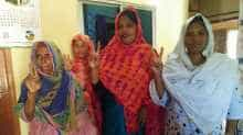 Pinki Khatun (2nd R), the first transgender candidate elected in Bangladesh, poses with local women in Kotchandpur.