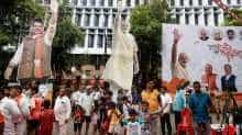 Cutouts and posters of BJP leaders are seen outside the party office in Maharashtra