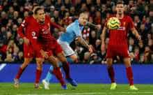Manchester City's Angelino shoots at goal against Liverpool
