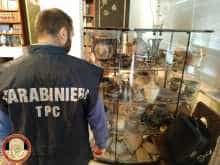 Carabinieri military policeman looks at artefacts in a display case in Cosenza, Italy.