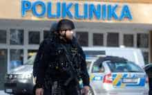 Policemen stand in front of the Faculty Hospital in Ostrava, eastern Czech Republic, after a gunman opened fire killing six people.