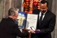 Ethiopia's Prime Minister Abiy Ahmed Ali receives the Nobel Peace Prize from Berit Reiss-Andersen during a ceremony in Oslo
