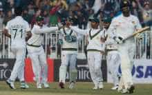 Pakistan cricketers celebrate dismissal of Sri Lanka's Angelo Mathews