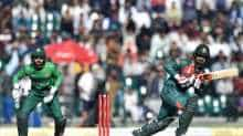 Tamim Iqbal plays a shot; Pakistan's wicketkeeper Mohammad Rizwan looks on
