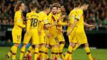 Barcelona's Lionel Messi and teammates celebrate after Clement Lenglet scores their third goal