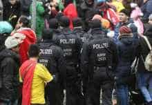 Police officers patrol during the Rose Monday carnival street parade in Duesseldorf, western Germany