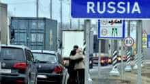 Family members hug each others as some of them leave Belarus before closing the Russian border