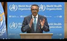 WHO Director-General Tedros Adhanom Ghebreyesus delivers a speech via video link at the opening of the World Health Assembly virtual meeting