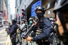 Riot police take part in a crowd dispersal operation in the Central district of Hong Kong