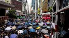 Pro-democracy protesters gather in Causeway Bay district of Hong Kong on May 24, 2020, ahead of planned protests against a proposal to enact new security legislation in Hong Kong