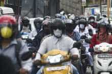 Commuters in a traffic jam during rush hour in Mumbai amid the coronavirus pandemic