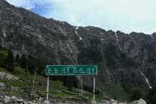 A roadsign displaying distances to Leh, the capital of the union territory of Ladakh, is seen along the Srinagar-Leh National Highway in Sonmarg some 89 Kms of Srinagar.